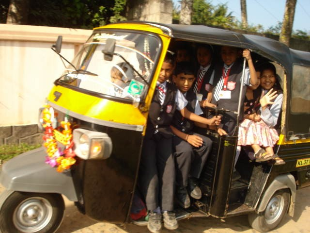 Coming home from school on an autorickshaw