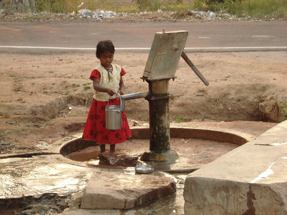 Some Indian villages have no running water so have to rely on a water pump.